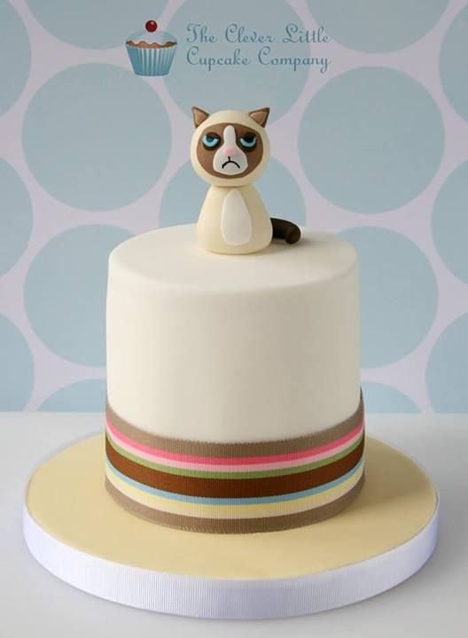 Grumpy Cat cake like the colurs of the cake but Id make the