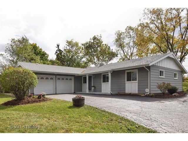 Residential property for sale in Lombard,IL (MLS #09066805). Learn more from Touchstone Group.  Live large in an OPEN living room with WOOD BURNING FIREPLACE and dining area.