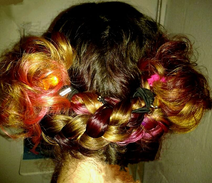 Fun hair style make low pigtails on each side, take one