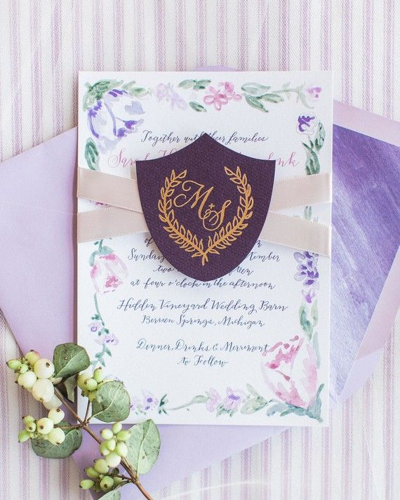 Laura Hooper Calligraphy created and calligraphed a pink-and-purplewatercolor design for this couple'sstationery suite. A gold-foiled crest with the couple's monogramheld the pieces together, along with a blush ribbon, and the envelope was lined with another paintedlavenderpattern.