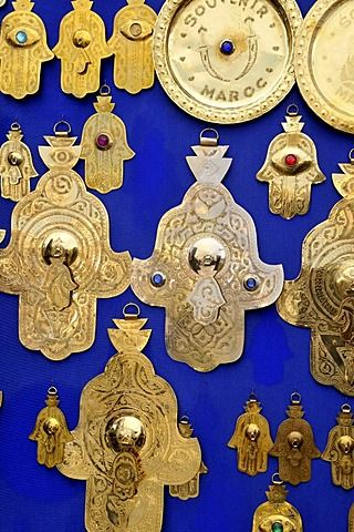 Hamsas or Hands of Fatima, good luck charms, in a souvenir shop at Place Djemma…
