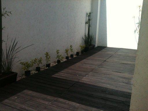 Piso de terraza con palets pallets - Hacer terraza en piso ...