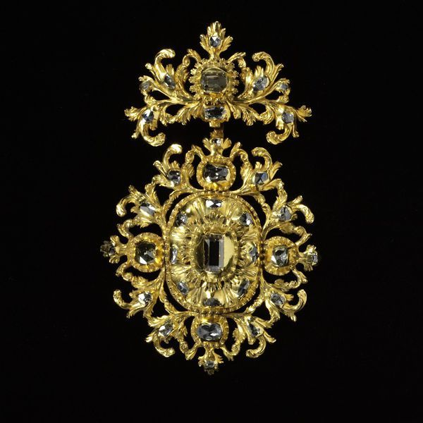 Pendant      Place of origin:      Spain (made)     Date:      ca. 1700 (made)     Artist/Maker:      unknown (production)     Materials and Techniques:      Table-cut and rose-cut diamonds set in gold openwork