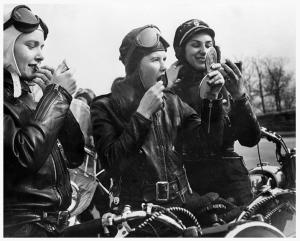 women bikers in leather helmets
