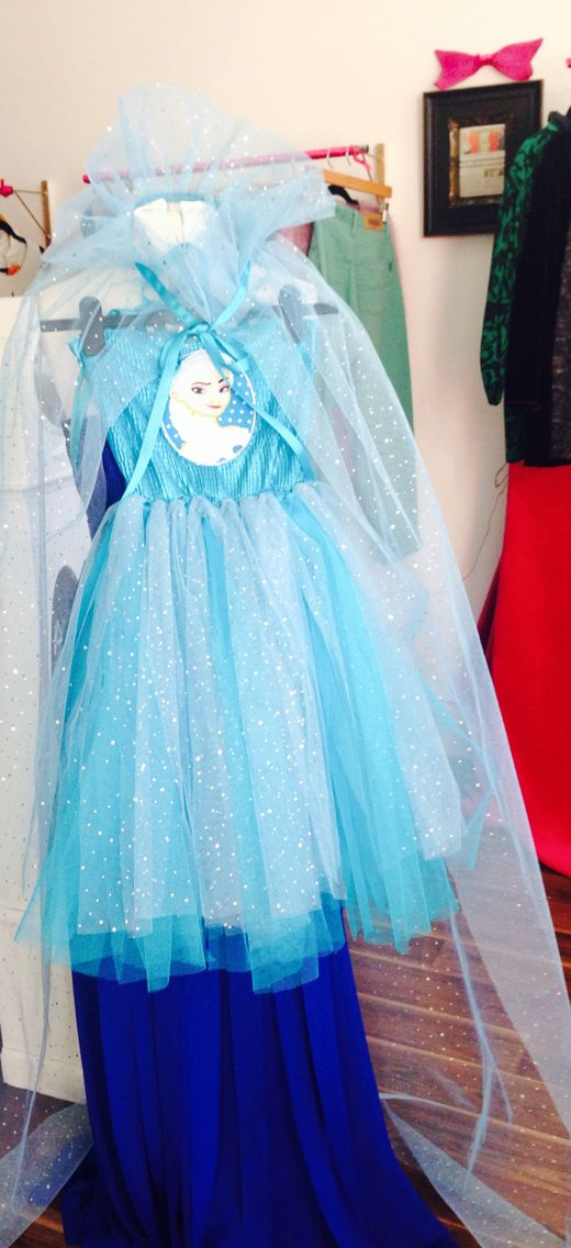 This little Elsa dress is available to order. Cape can be to any length. Example shown is extra long to trail along floor. Every little girls dream Elsa dress!! Guide price £35-£45. Contact me with following details for a price:   Height Waist Chest Neck to hem length  Cape length (knee, floor or trailing length.