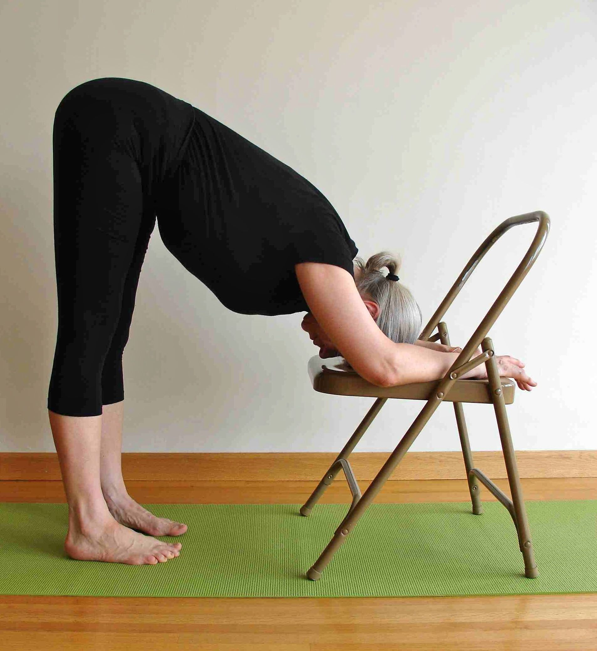 Chair yoga poses - Standing Forward Bend Pose With Chair
