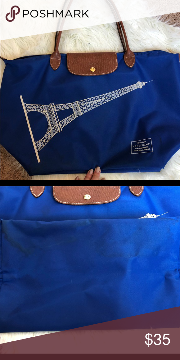 ce03ab87abf2 Longchamp Le Pliage tote Large Longchamp navy tote. Limited edition Eiffel  Tower design. Long handle. Used condition. In the last picture sign of  spilling ...