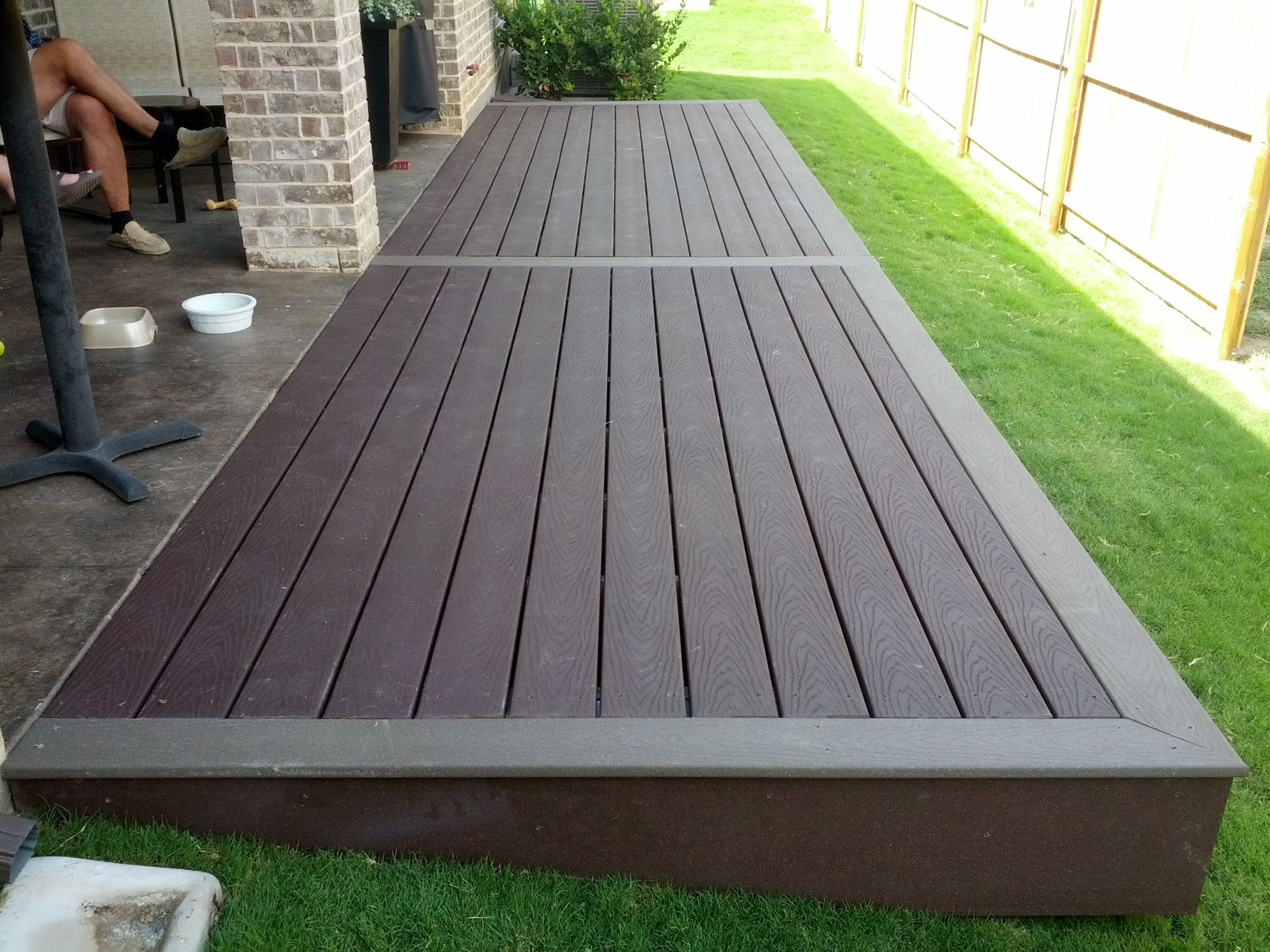 Multi color trex deck step down from patio big enough to for Garden design decking areas