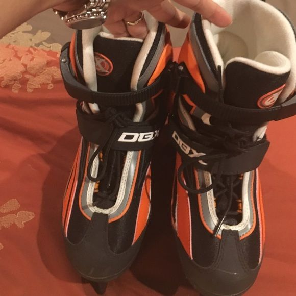 Ice Skates Boys adjustable ice skates. Black, orange, grey and a little of white.  This are boys but was my daughter's she used it about 10 times. Some scuffs from the wear but still in good condition. It adjusts 4 sizes. DBX Other