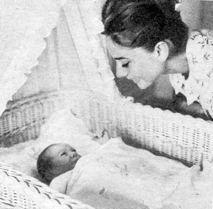 New mother Audrey Hepburn (and her dog) admire newborn baby son Sean at home, 1960.