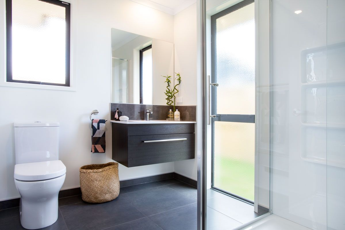 Stunning Ensuite With Grey Floor Tiles And Black Vanity Paired With White Walls And Shower Bathroom Grey Flooring Black Vanity Bathroom Bathroom Renovations
