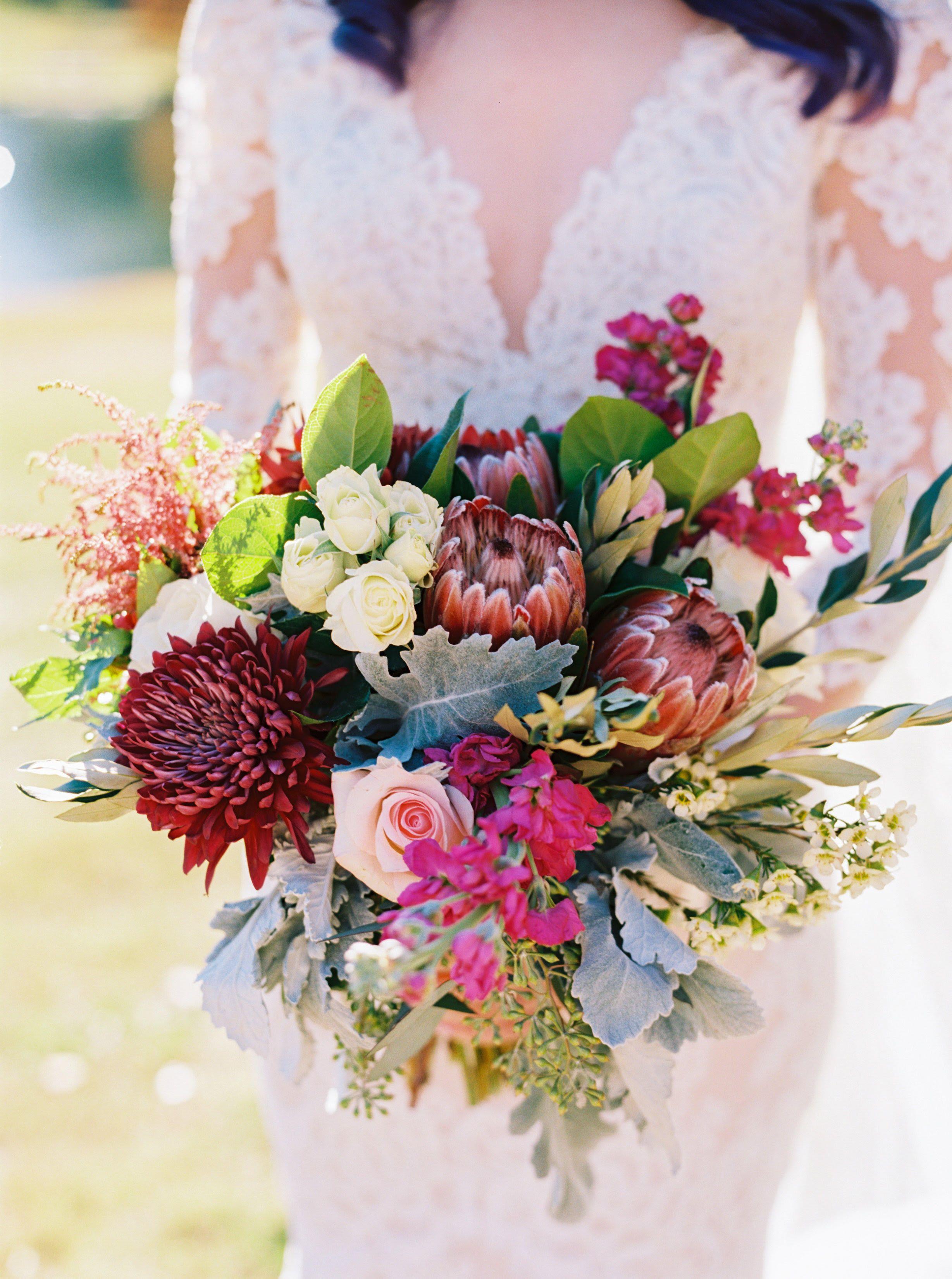 Brides bouquet with protea flowers. Laurel dress by Anne Barge ...