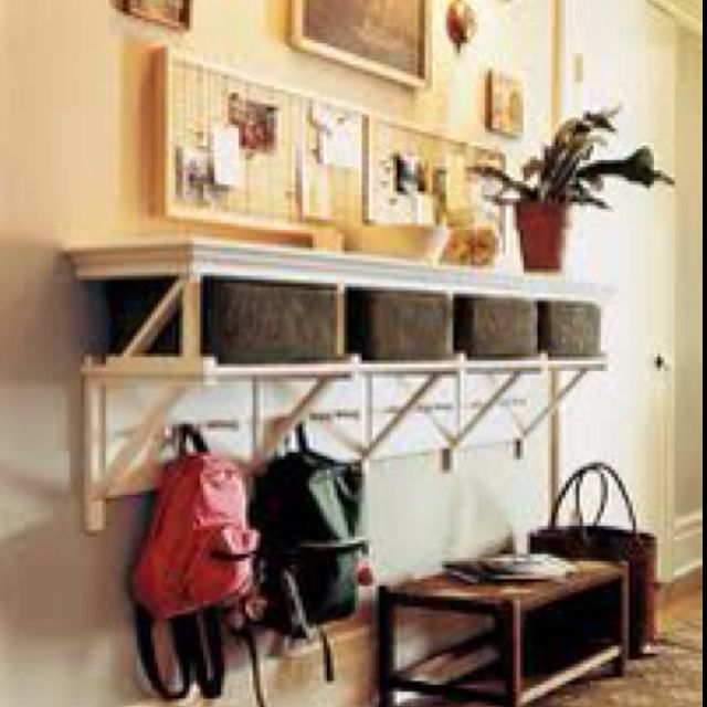 Entryway storage idea-hook system with shelf on top with vertical pin for school homework/papers