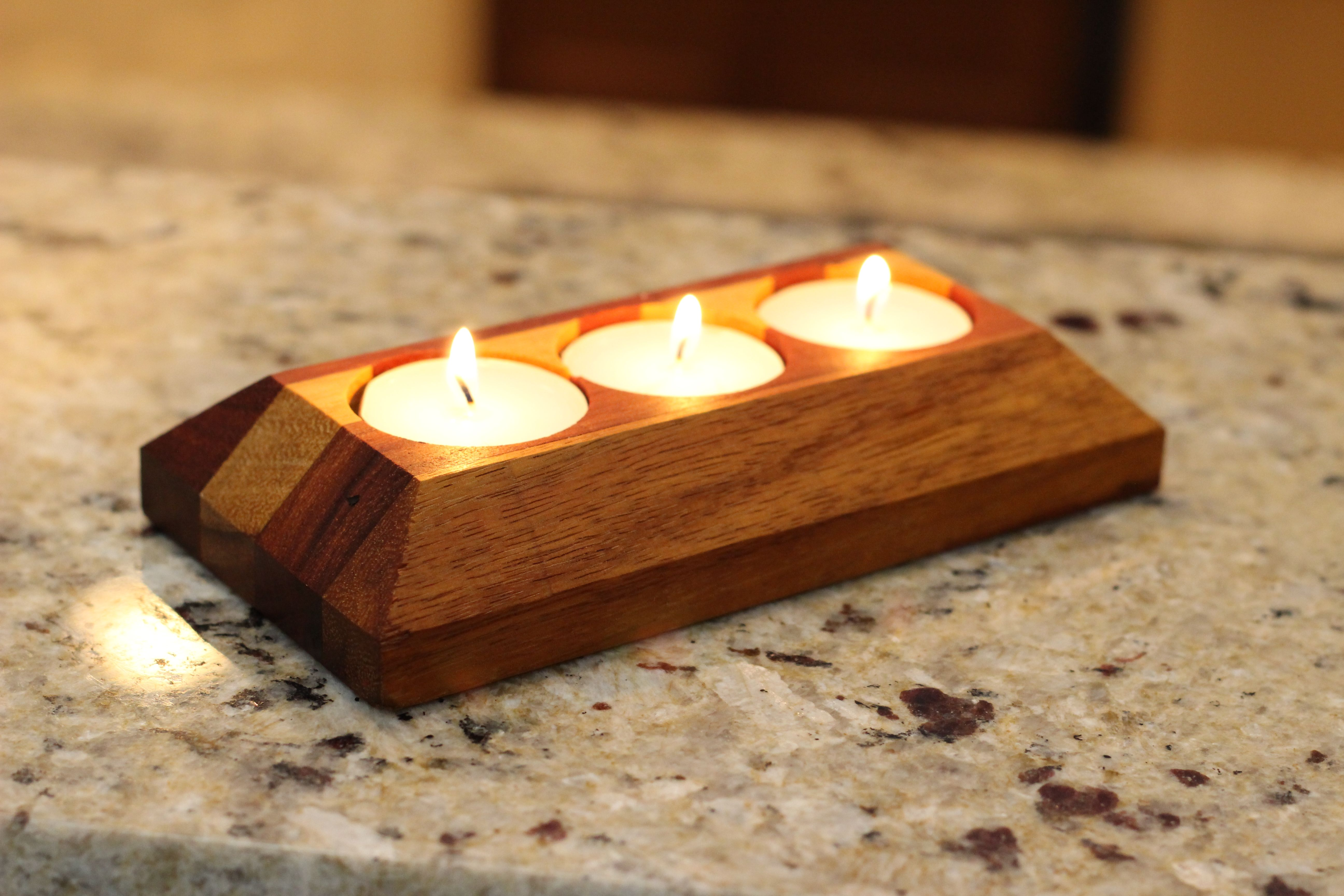 This alluring candle holder was meticulously crafted from the vibrant and exotic hardwoods, ganadillo and marble-wood. The subtle earth tone colors make this an excellent decorative piece for any mantle or shelf while the soft glow of it's candle-lights provide an excellent source for ambient lighting. Don't miss out on your chance to give this rare candle-holder a home, order yours today!