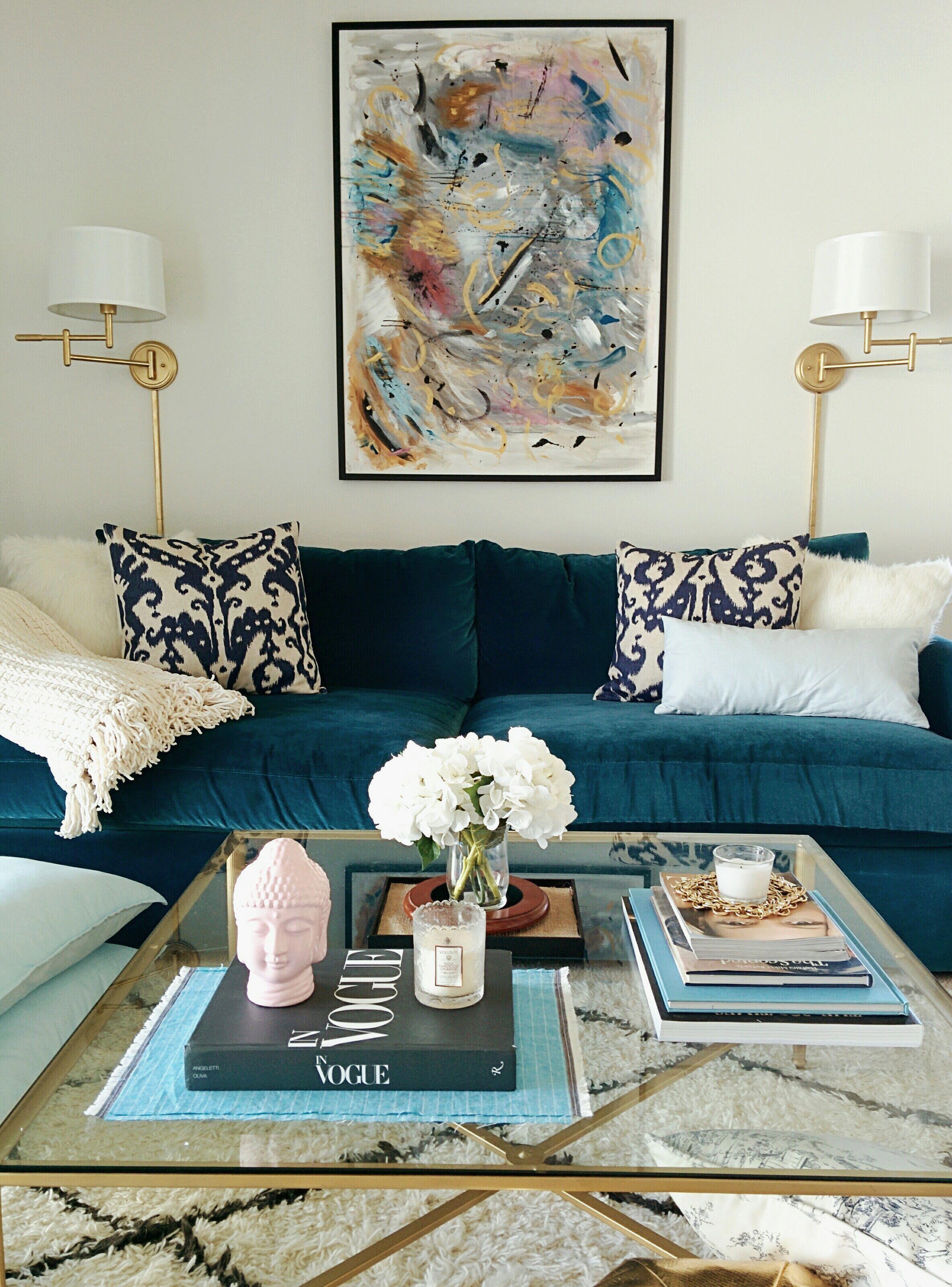 My living room! Velvet sofa, ikat pillows, moroccan rug ...