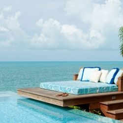 This infinity edge pool on a bluff melds into the ocean with a day bed to dream on! -- Turks & Caicos Islands