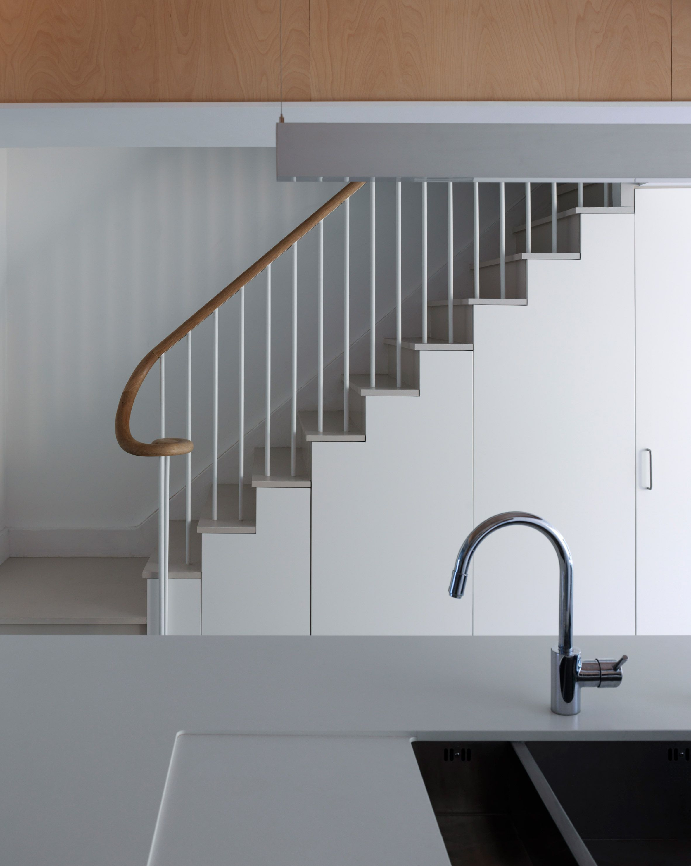 Storage Is Built Into The Space Below A New Staircase,