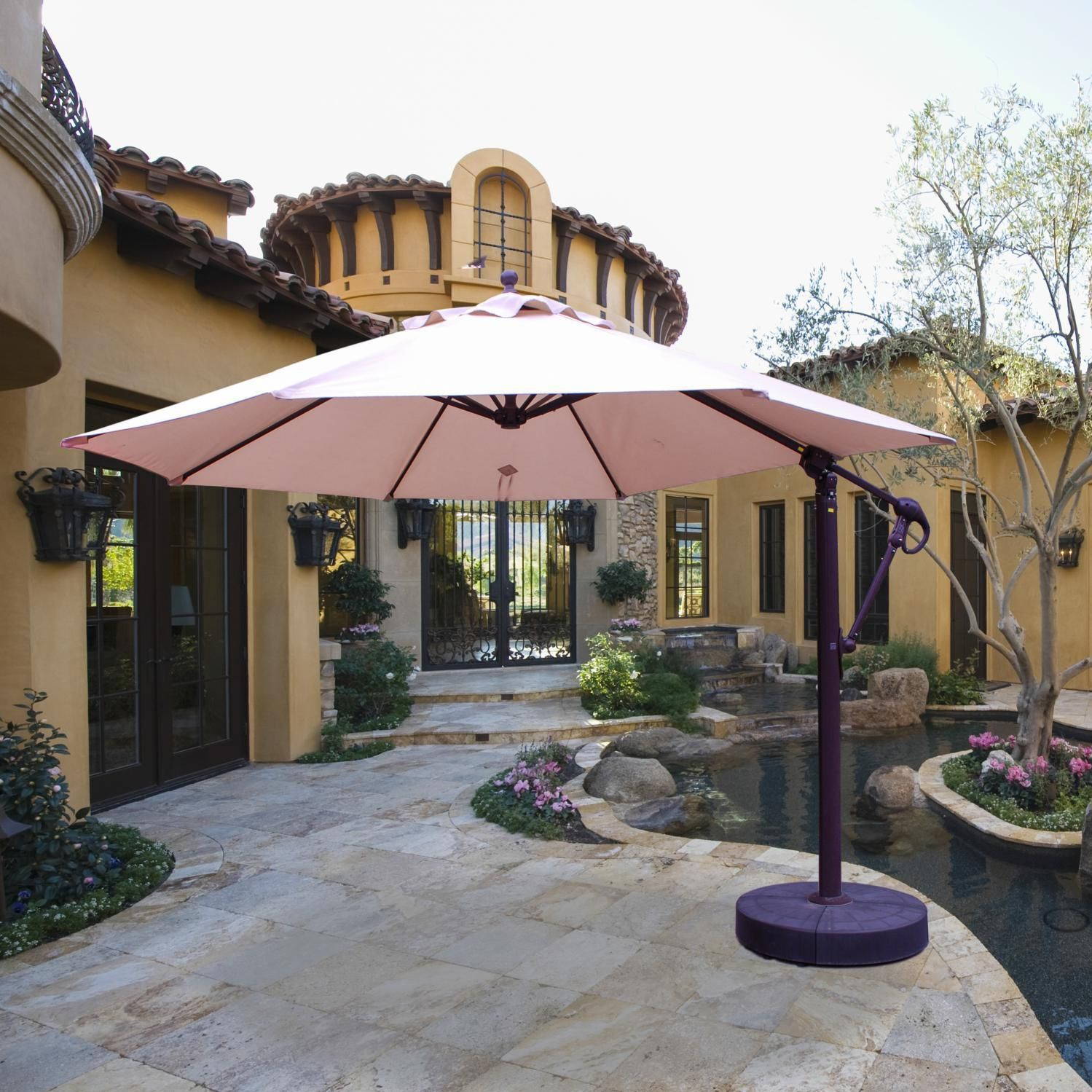 The Galtech 11ft cantilever patio umbrella features an easy lift