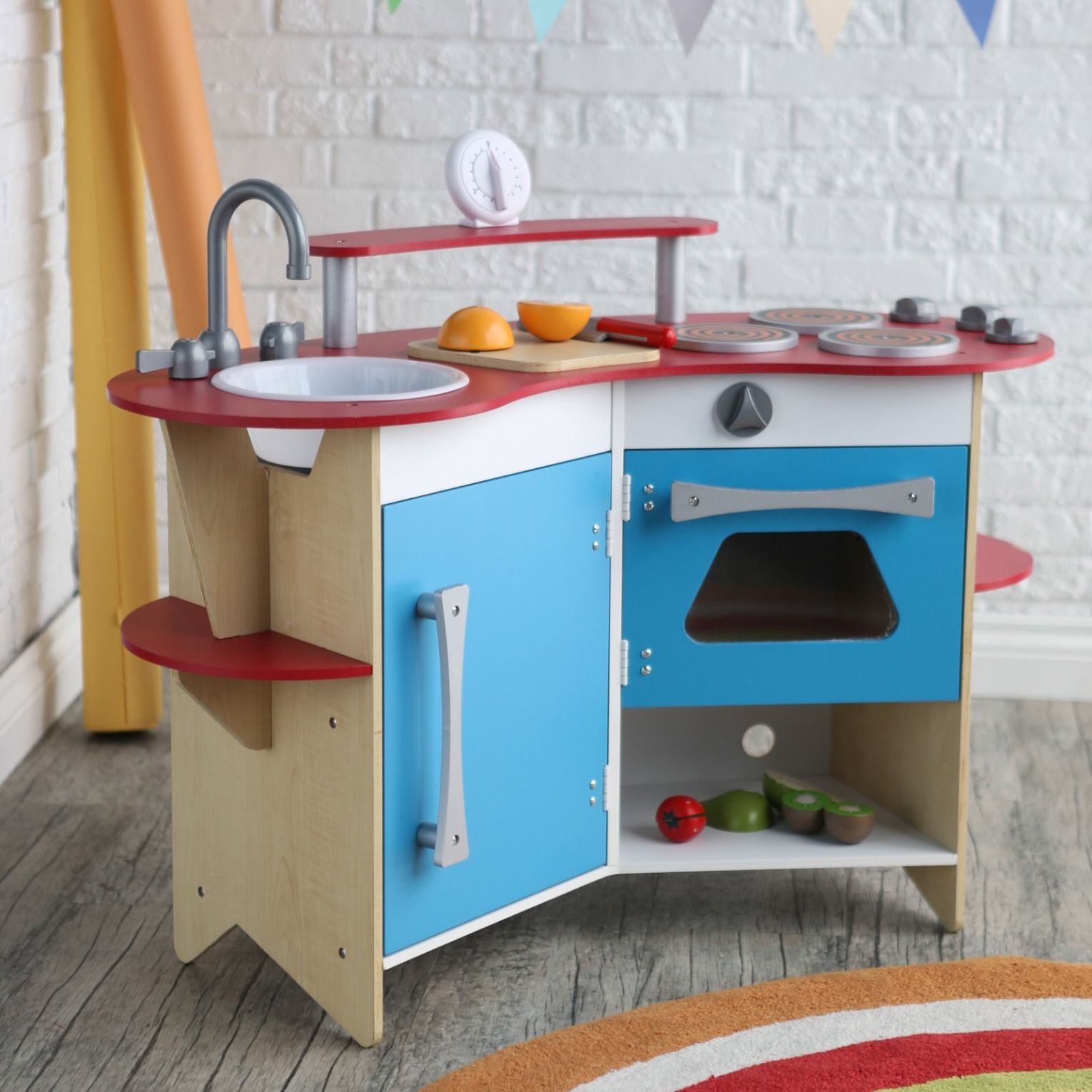 Your aspiring chef will love this cute, compact play kitchen from ...