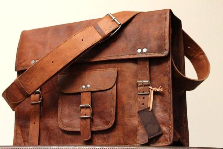 Pretty sweet.  18x13x6 Leather School Bag Cum Messenger Bag / Satchel - Vintage Retro Looking. $94.00, via Etsy.