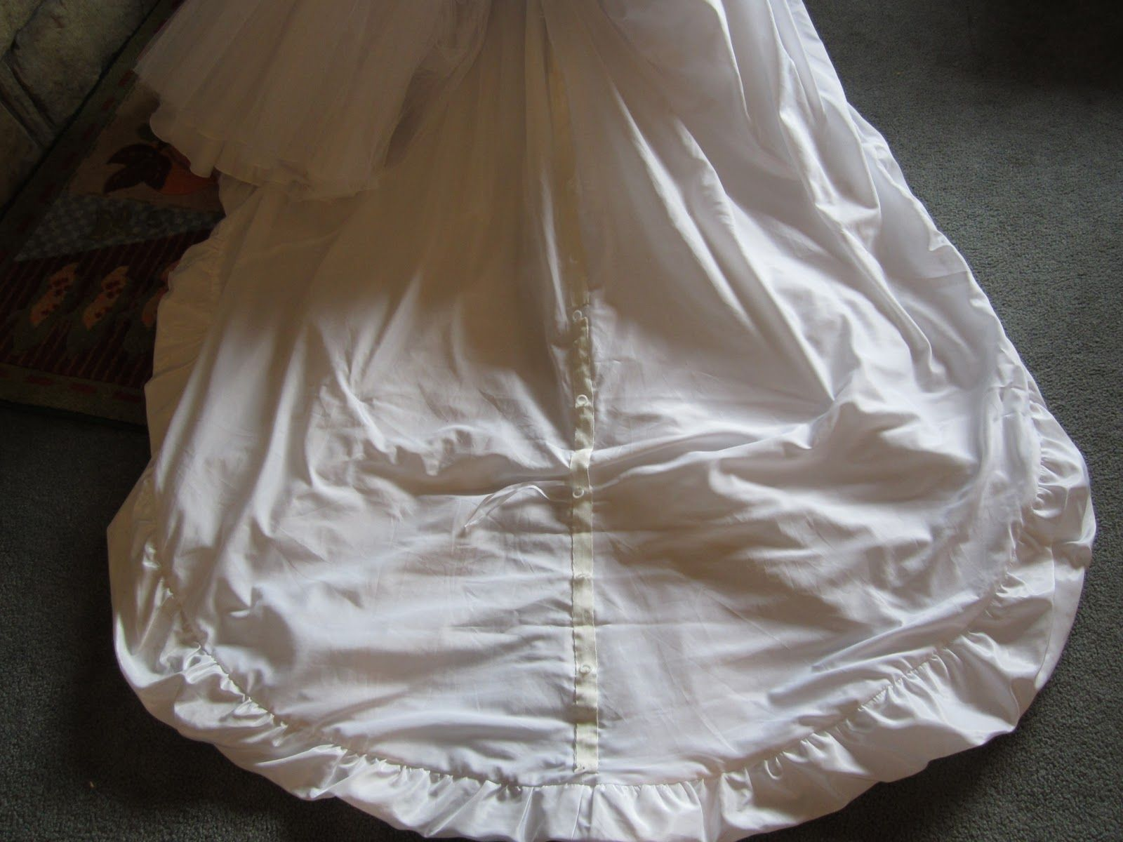 how to bustle a wedding gown with ring tape (used to make roman ...