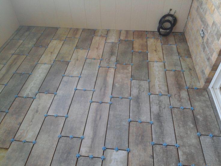 Barnwood tile in sun room - 7cb91fc5c44ac022b0703666593964f4.jpg 736×552 Pixels Tile Floor