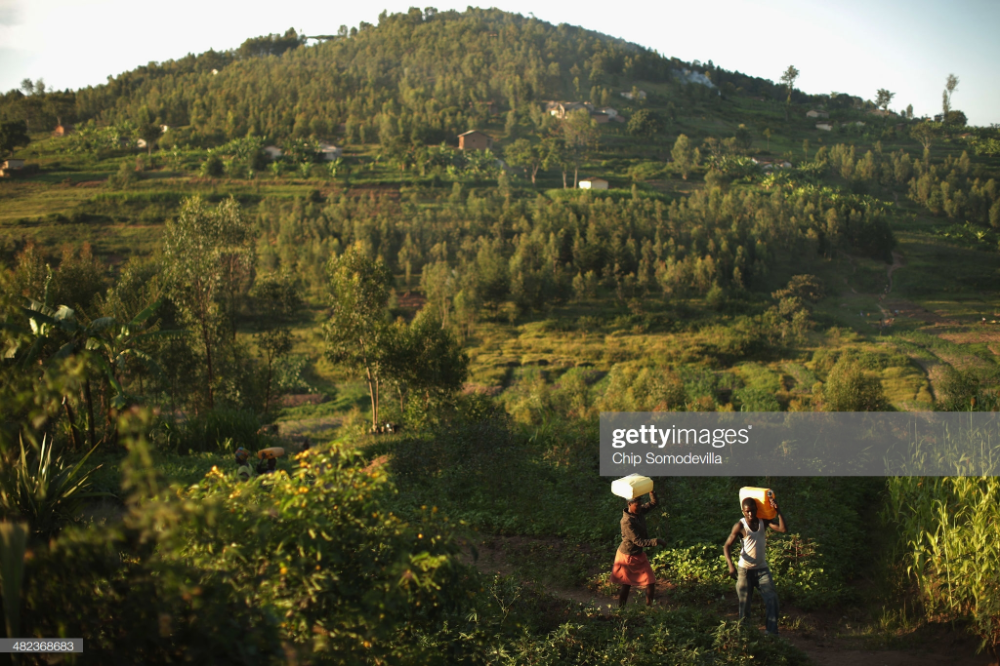 News Photo : People carry plastic jugs of water from a well to... #plasticjugs