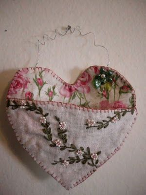 As a gift holder.  Vintage Embroidered linens.