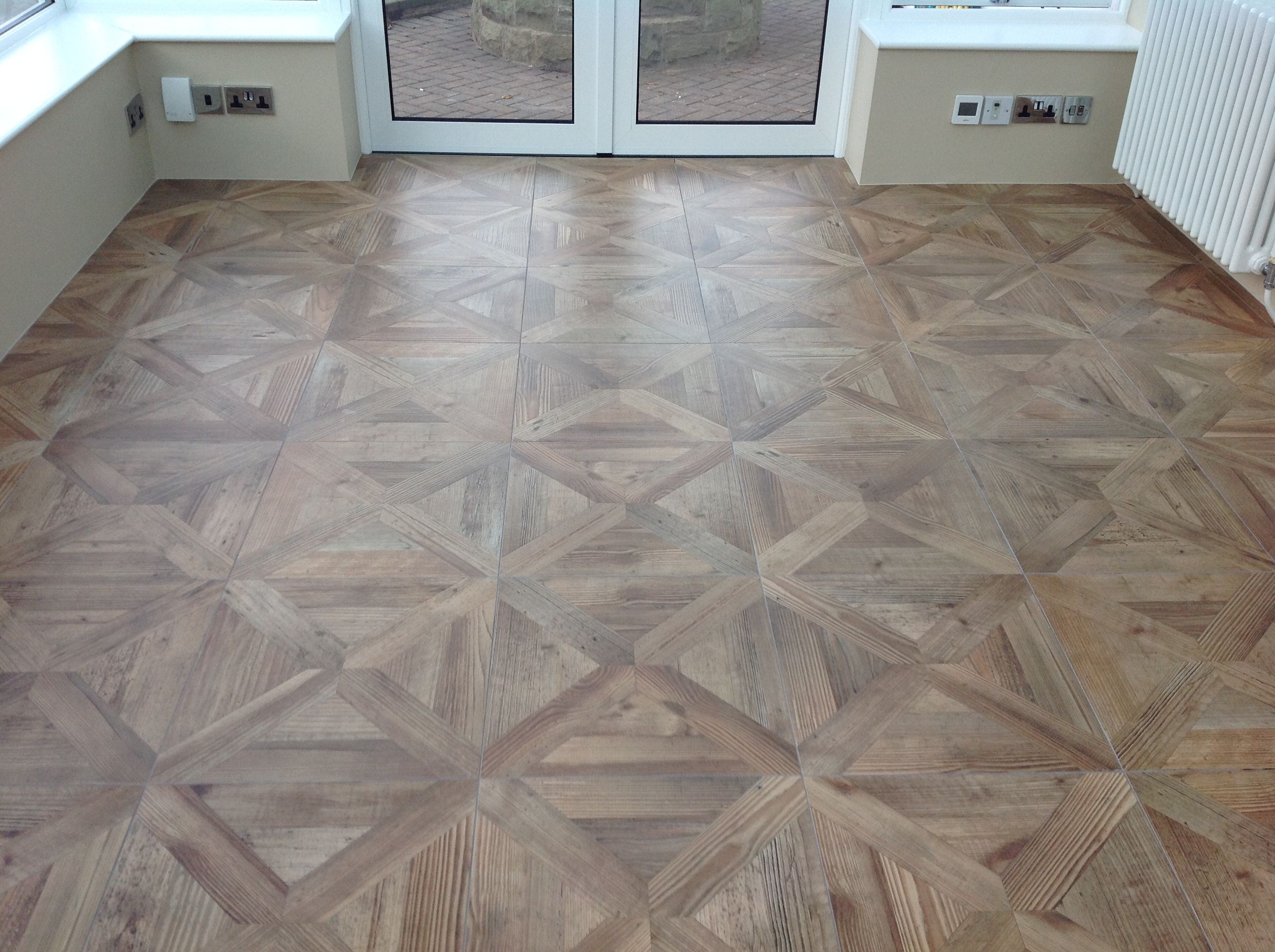 Parquet wood effect porcelain floor tiles give a fabulous finish to parquet wood effect porcelain floor tiles give a fabulous finish to this conservatory with undertile dailygadgetfo Gallery