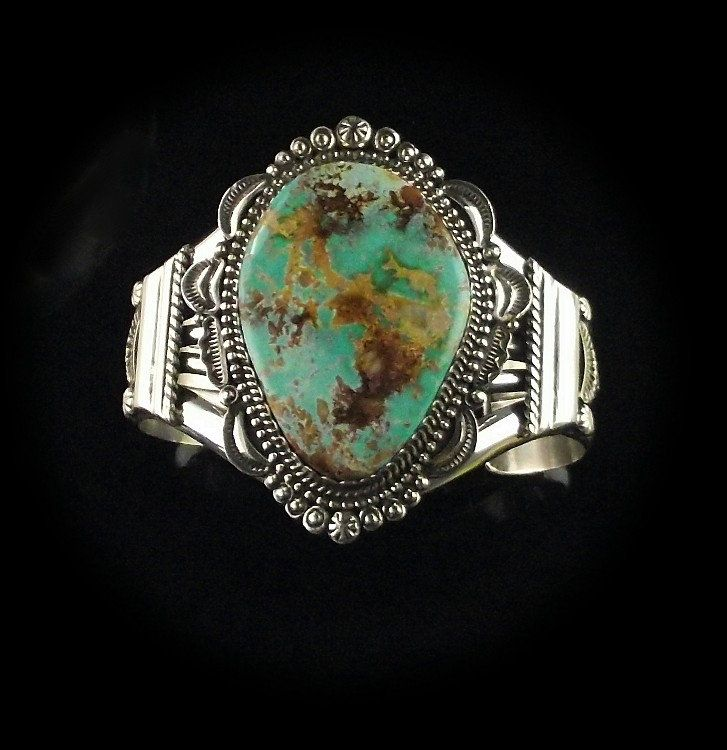 Beautiful sterling and turquoise bracelet by navajo artist