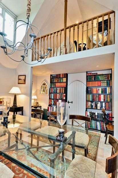 Colourful Bookcases Looking Great Against Minimalist Decoration