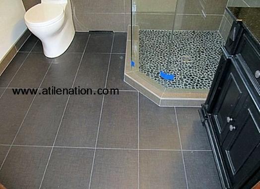 porcelain tile flooring and pebble tile shower pan | bathroom