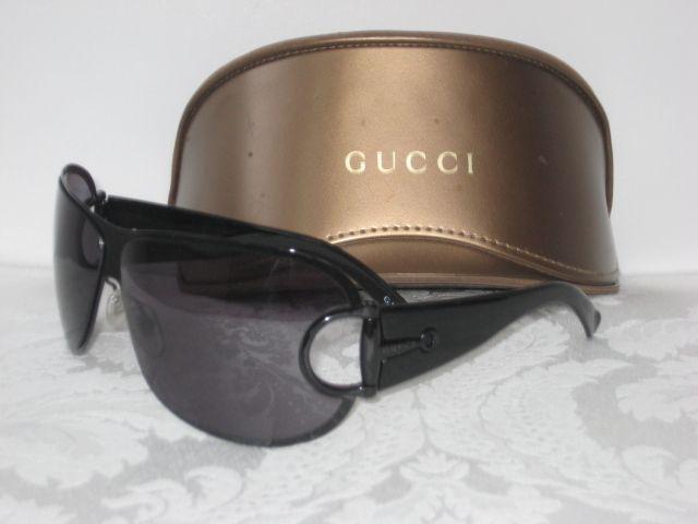 63280ffc343 Gucci sunglasses. Black frames   lens. Aviator style with black horsebit    logo detail on arms.  179.50