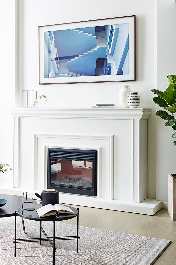 Samsung S New Tv The Frame Is So Chic It Can Be Disguised As A Work Of Art Ad Framed Tv Glam Living Room Home Fireplace