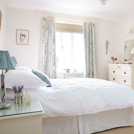 Crisp White Bedroom With Pale Blue Accents