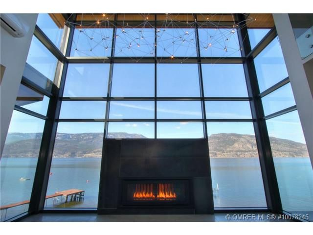 A fireplace set within a glass wall. Have you ever seen a home quite like this? Kelowna, BC Coldwell Banker Horizon Realty $3,482,515