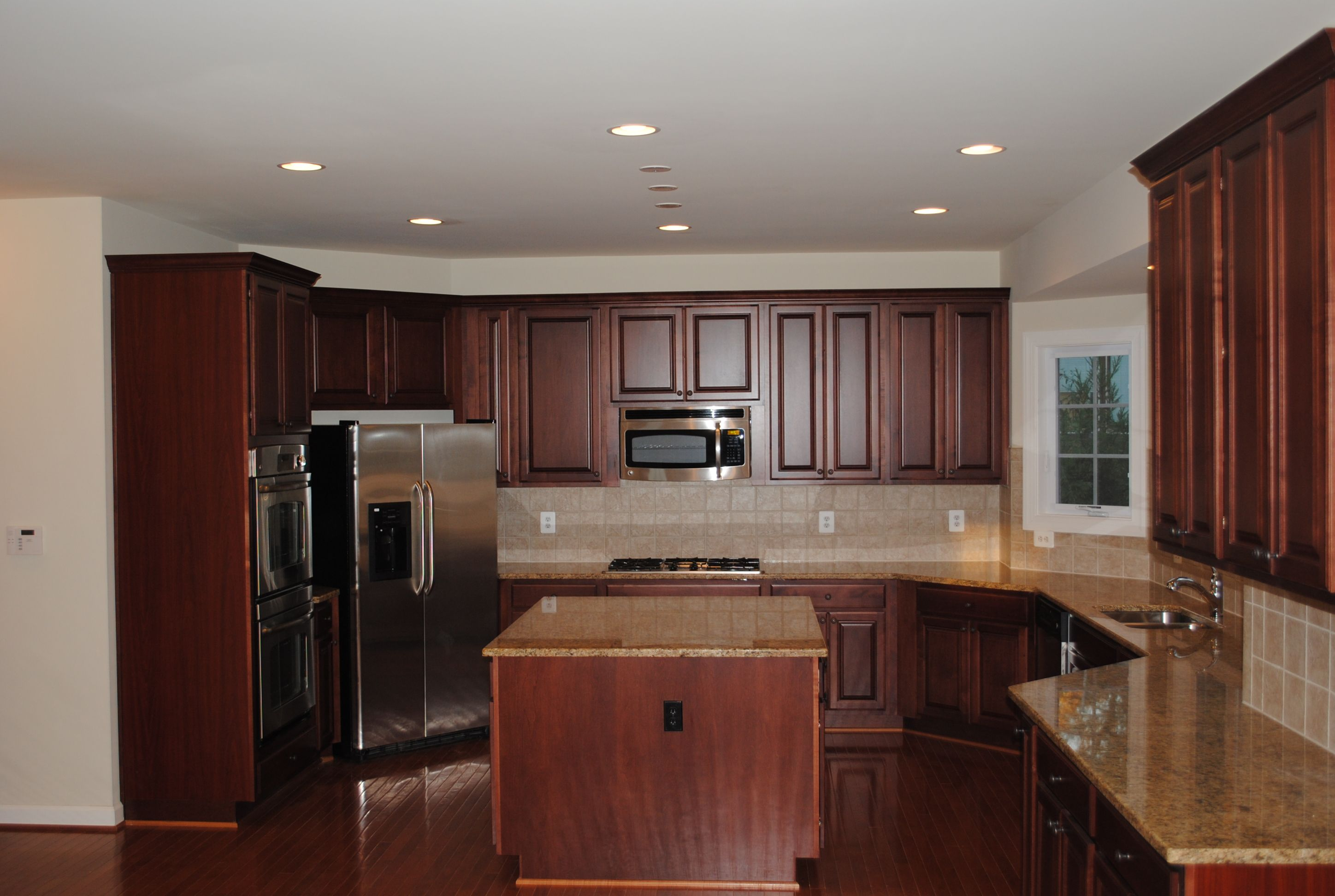 Kitchen With Merlot Cabinets And New Venetian Gold Granite Countertops Gold Granite Countertops Kitchen New Venetian Gold Granite