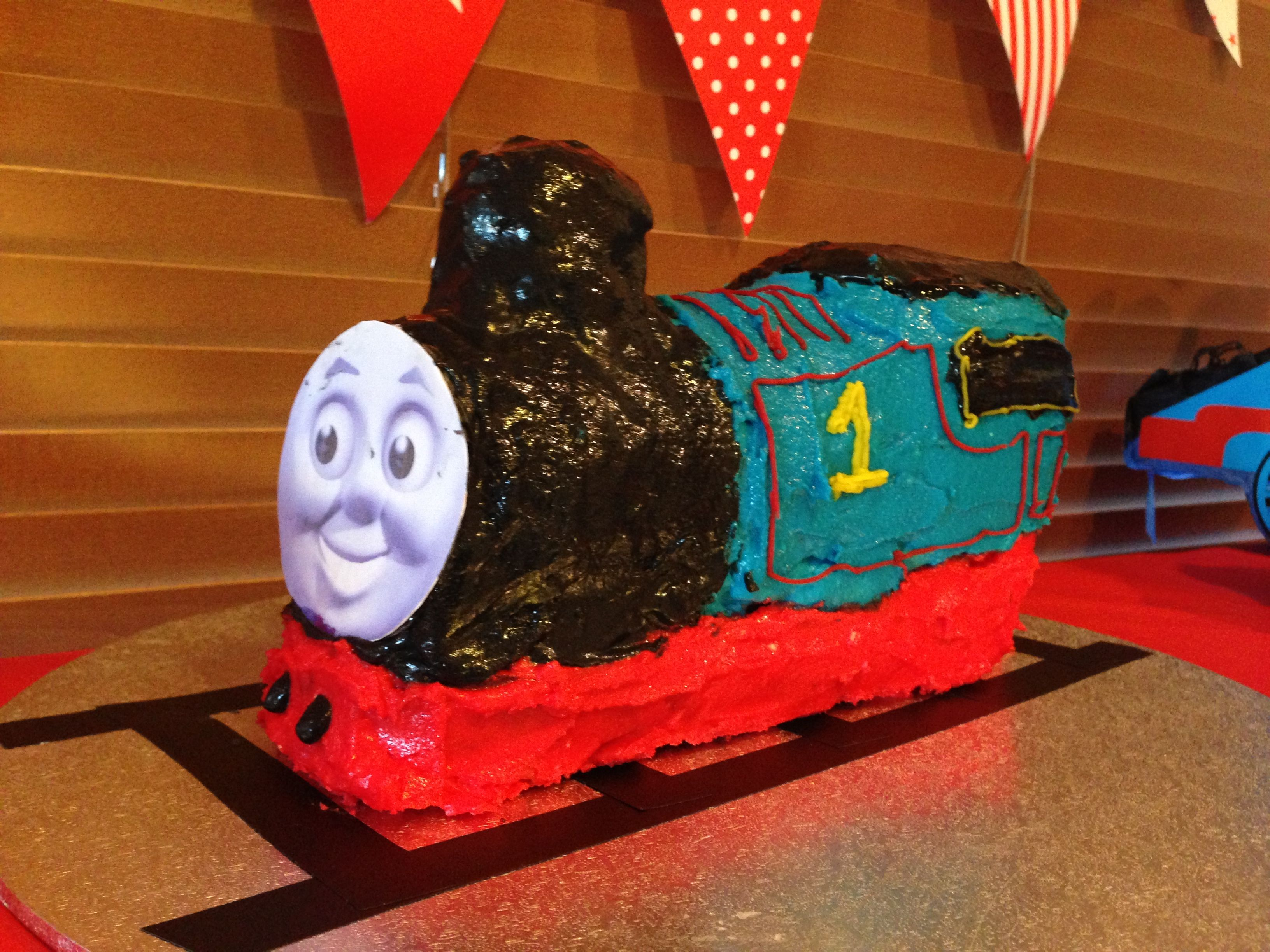 Attempted Thomas tank engine cake with cardboard face (fondant too fiddly).
