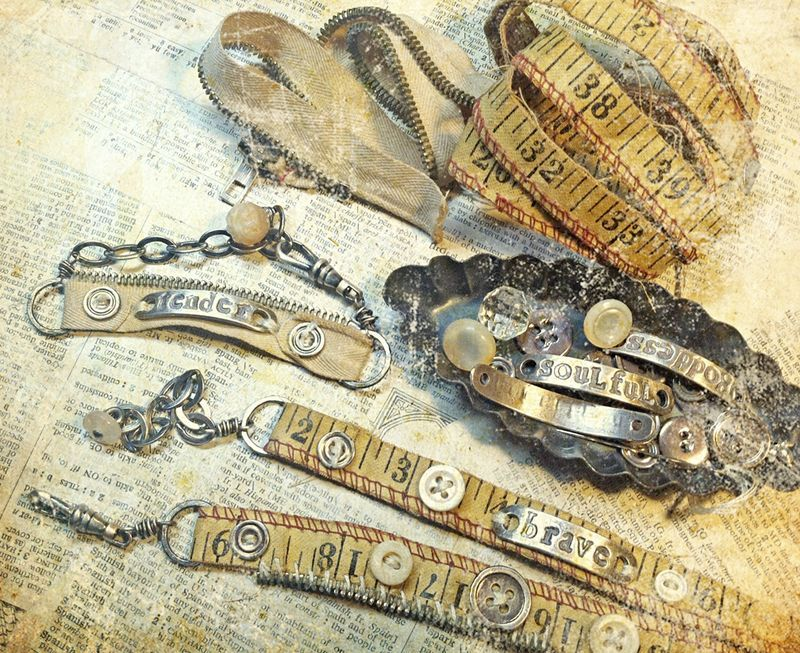 nina bagley.  I just *love* the buttons and stamping and the vintage measuring tape, omg.