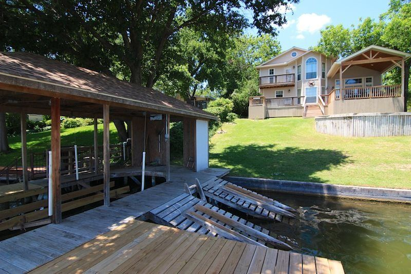 Dual jetski ramp swimming deck boat lift lake house