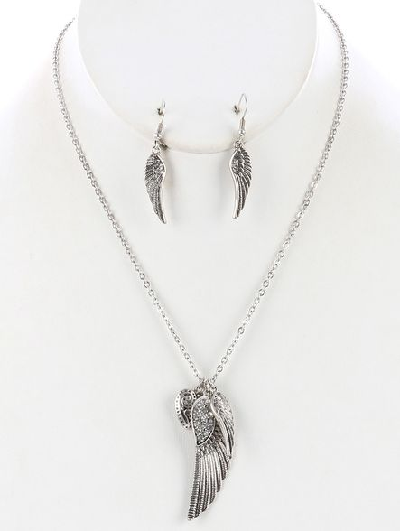 Arabella Ave by Tina  http://www.arabellaave.com/?a_aid=TinaGowans   AGED FINISH METAL WING WITH HEART PENDANT NECKLACE AND EARRING SET $16.95 METAL WING PENDANT HEART CHARM TEXTURED SWIRL PATTERN PAVE CRYSTAL STONE LINK CHAIN FISH HOOK 18 INCHES LONG 2 INCH DROP NICKEL AND LEAD COMPLIANT