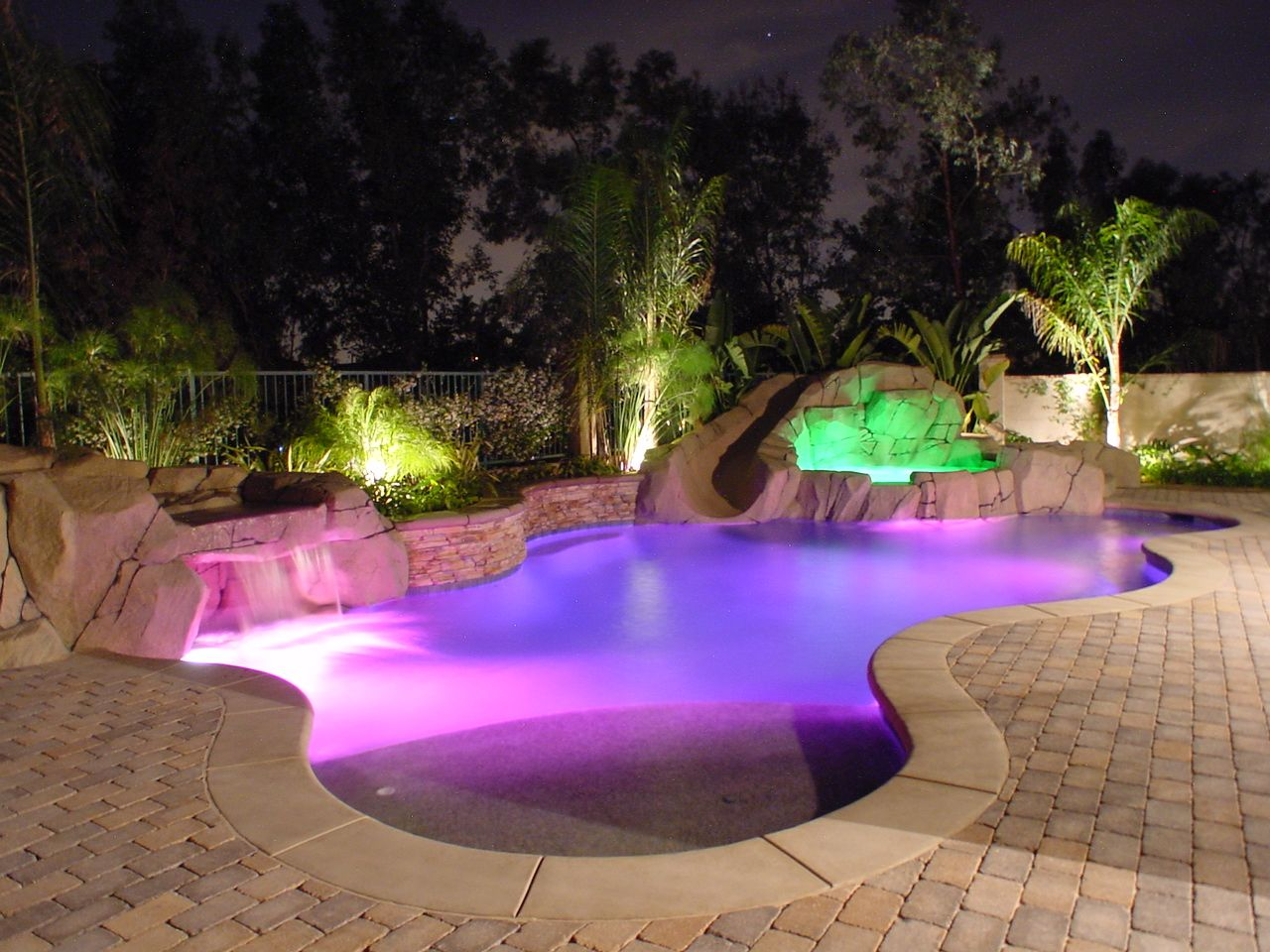 beach entry pools design and music features for your custom swimming pool - Custom Swimming Pool Designs