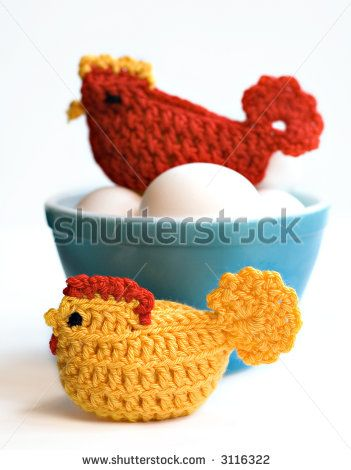 Crocheted chicken cozies sitting on eggs - shallow depth of field by Denise Kappa, via ShutterStock