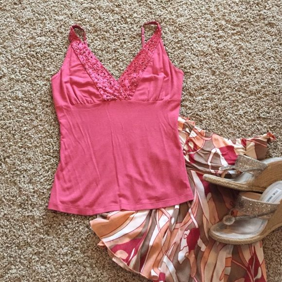Totally cute Bebe top This Bebe shirt has only been worn a handful of times. Needs a new home! Pair it with a skirt or skinny jeans and heels! You can also wear it under another shirt. Fun Versatile Top! It is a coral color. bebe Tops