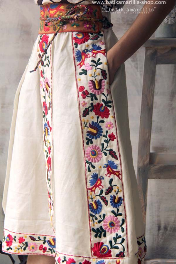 Batik Amarillis made in Indonesia proudly presents Batik Amarillis' folklore#2 vol#1 Transylvanian skirt  mini obi belt it's such a unique  folkloric skirt inspired by traditional costume in Transylvania , with meticulous intricating Hungarian embroidery folk art style you can enjoy the beauty of flowers,leaves and birds on its embroidery