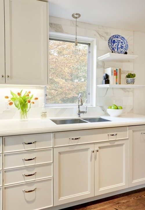 Great Beautiful Kitchen With Off White Kitchen Cabinets With Beveled Marble  Countertops And Marble Backsplash,