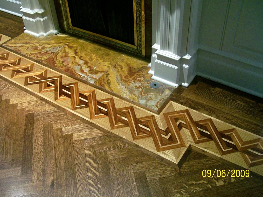 Hardwood floor border around the fireplace mini for Hardwood floor designs borders