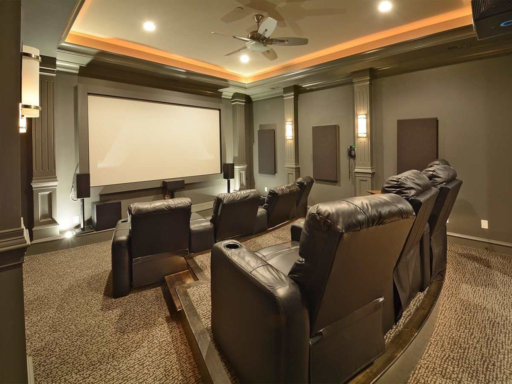 Traditional Home Theater With Ceiling Fan Crown Molding Wall Sconce Flush