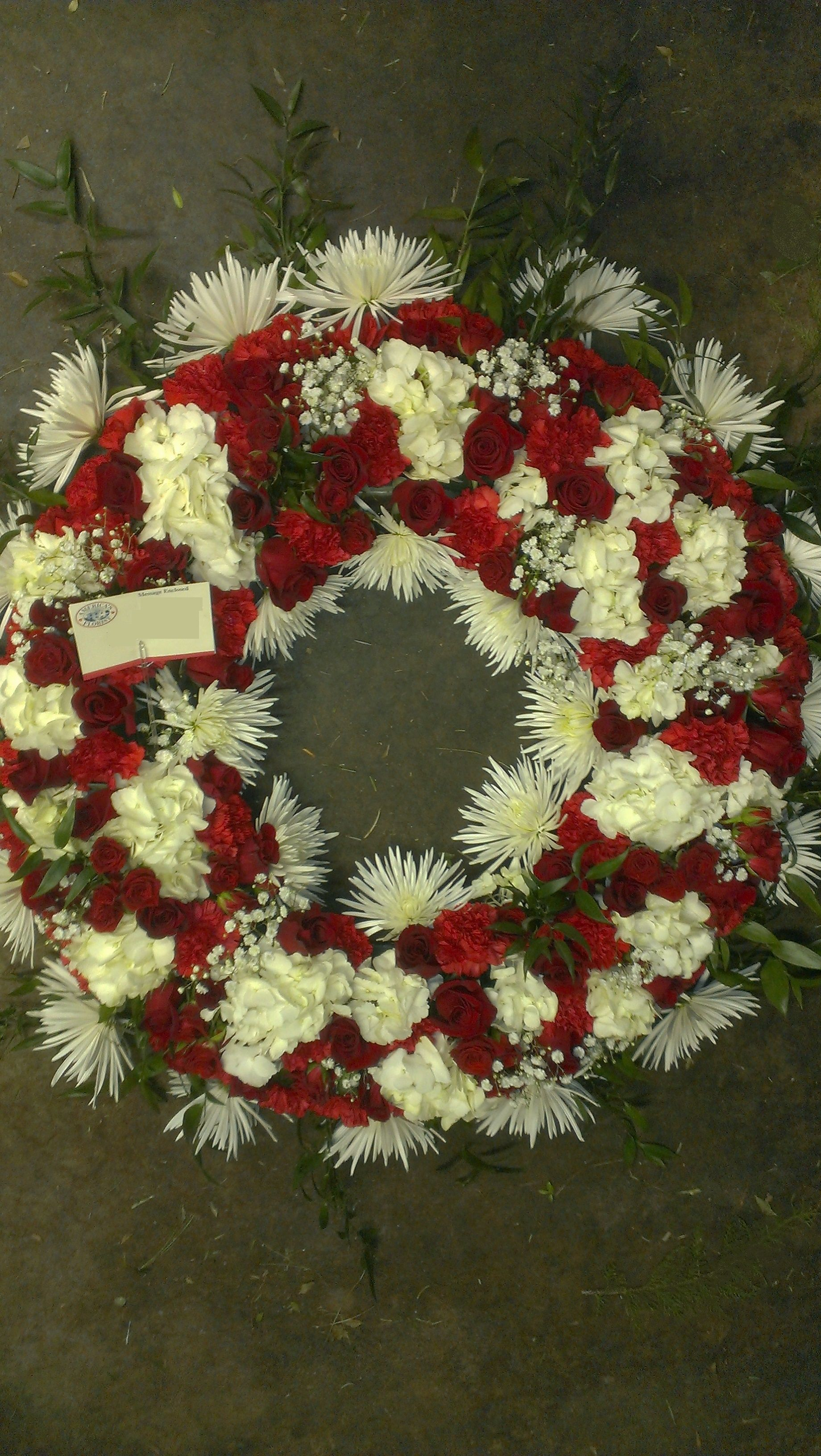 Local funeral wreath red and white in color