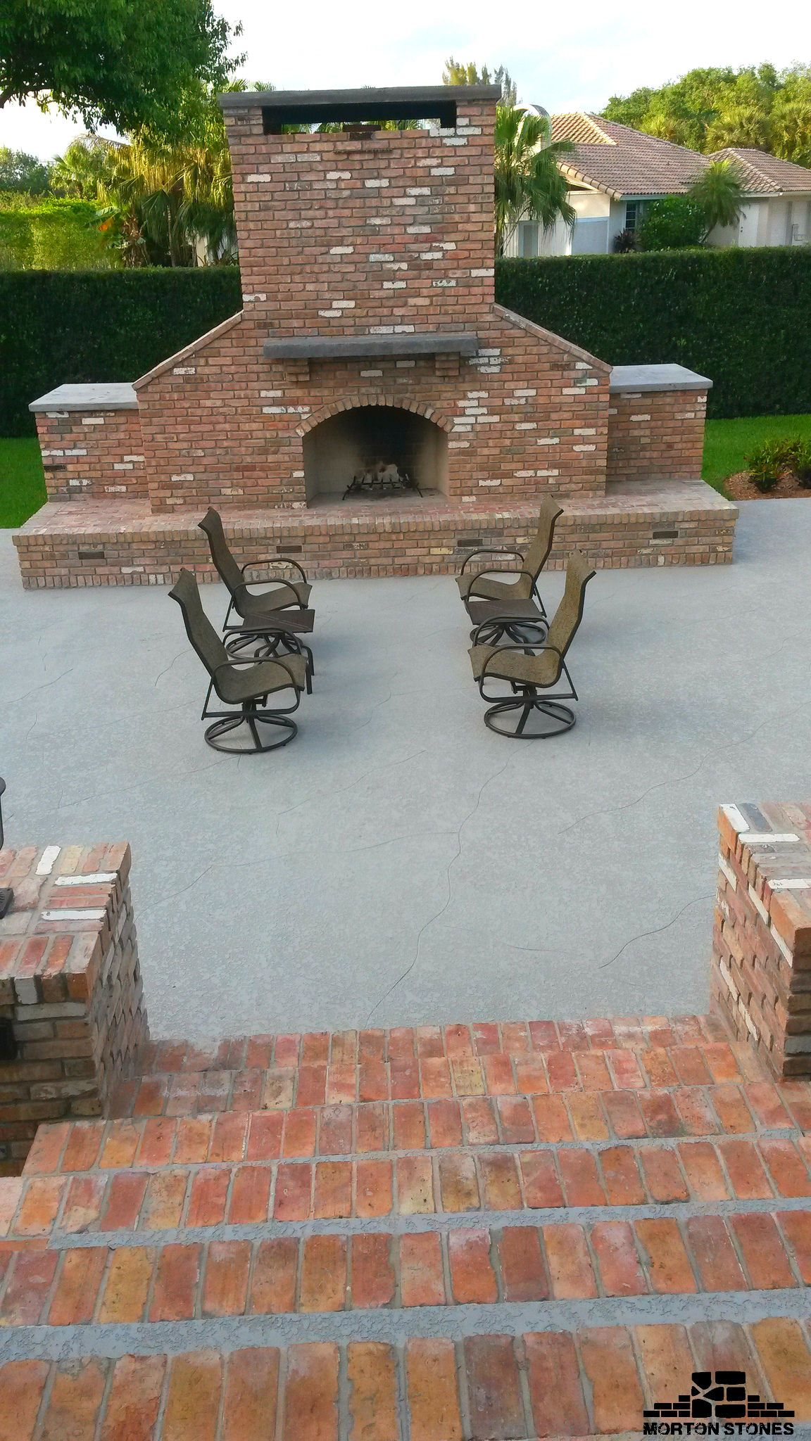 Building an outdoor brick fireplace will make your